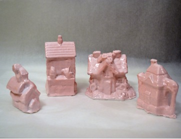 "Tchotchke House Collection Molded porcelain From left: 3.5""x1.5""x2.25"", 4""x2.5""x2.25"", 3""x4.5""x2.25"", 3.25""x3.75""x2.25"" 2013"