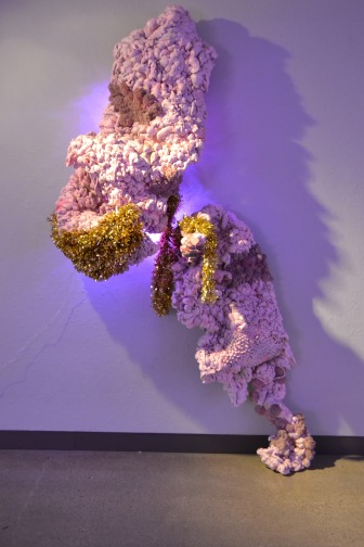 "Lump #1 96"" x 30"" x 9"" Insulation foam, handmade pom poms, chicken wire, plywood, LED lights, acrylic paint, craft pom poms, piped latex caulk, plastic curlers, holiday garland 2016"